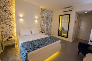 A bed or beds in a room at ibis Styles Palmas