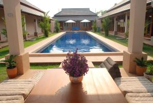 The swimming pool at or near Lanna Thai Villa Home Stay