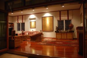 The lobby or reception area at Lanna Thai Villa Home Stay