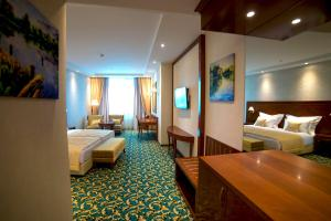 A bed or beds in a room at Hotel Mellain