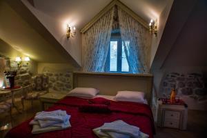 A bed or beds in a room at B&B Casa del Sol Rozalija