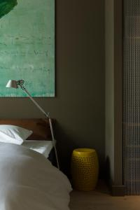 A bed or beds in a room at Blue Inspired by Manna