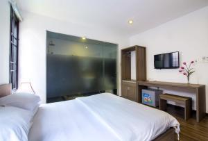 Ein Bett oder Betten in einem Zimmer der Unterkunft Ki Nô Homestay