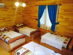A bed or beds in a room at Olympos Orange Bungalows