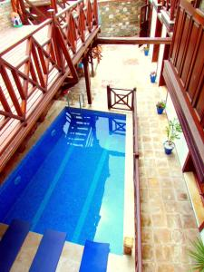 The swimming pool at or near Amazon Petite Palace