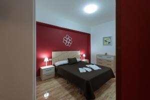 Cama o camas de una habitación en Apartamentos Vacacionales Las Palmas Urban Center