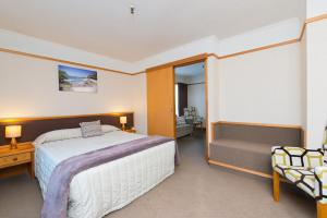 A bed or beds in a room at Distinction Whangarei Hotel & Conference Centre