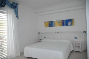 A bed or beds in a room at Elaia Garden Hotel