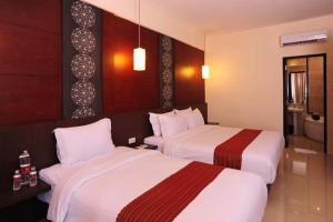 A bed or beds in a room at Savali Hotel