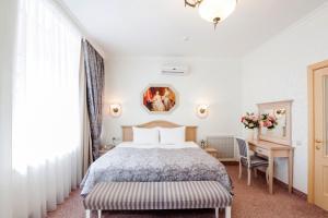 Кровать или кровати в номере Отель Грин Лайн Самара