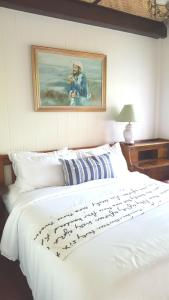 Een bed of bedden in een kamer bij Villa Mungkala