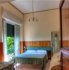 A bed or beds in a room at Hotel Primo Sole