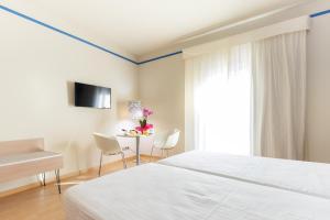 A bed or beds in a room at Ciutat de Barcelona