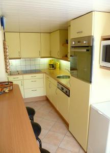 A kitchen or kitchenette at Villa Le Bon Temps