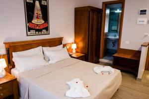 Letto o letti in una camera di Reboa Resort