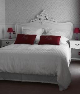 Un ou plusieurs lits dans un hébergement de l'établissement Auberge Batby