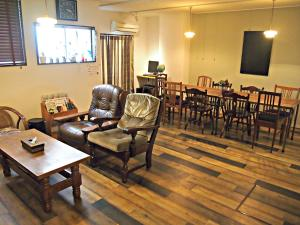 A restaurant or other place to eat at J-Hoppers Hiroshima Guesthouse