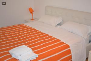 A bed or beds in a room at Sun Garden l.t.