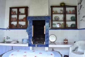 A cozinha ou kitchenette de Casa do Sol Poente