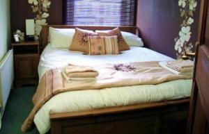 A bed or beds in a room at Ty Rosa Boutique B&B