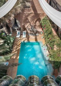 A view of the pool at La Sultana Marrakech or nearby