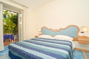 A bed or beds in a room at Albergo Terme Italia