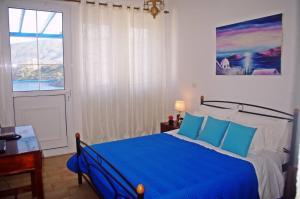Ένα ή περισσότερα κρεβάτια σε δωμάτιο στο Rania Studios