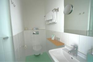 Ein Badezimmer in der Unterkunft Hotel Johann