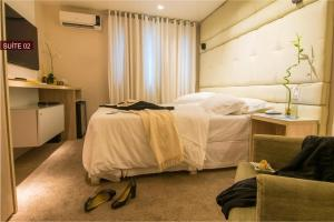 A bed or beds in a room at Modevie Boutique Hotel