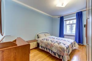 Кровать или кровати в номере Welcome Home Apartments Nevskiy 54
