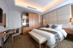 Cama ou camas em um quarto em Grand Park Hotel