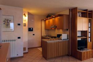 Kuchyň nebo kuchyňský kout v ubytování Appartamenti Fabrizio