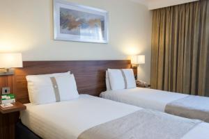 A bed or beds in a room at Holiday Inn Ashford Central, an IHG Hotel