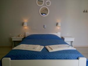 A bed or beds in a room at Avra Beach Hotel