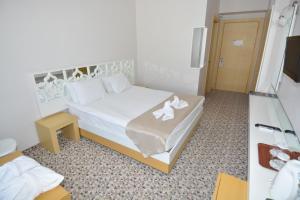 Cama o camas de una habitación en Tripolis Hotel