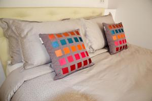 A bed or beds in a room at Assia & Nathalie - Luxury B&B MARAIS