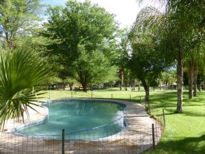 The swimming pool at or near De Werf Lodge