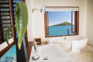 A bathroom at Likuliku Lagoon Resort - Adults Only