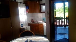 A kitchen or kitchenette at Holiday Home Manda