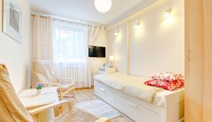 Łóżko lub łóżka w pokoju w obiekcie Apartament Brzeźno