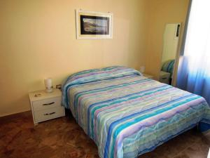 A bed or beds in a room at Sole e Mare