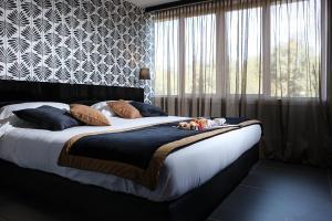Letto o letti in una camera di Best Western JFK Hotel
