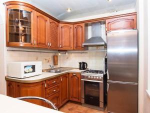 Кухня или мини-кухня в ApartLux Люкс на Савеловской