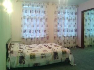 Кровать или кровати в номере Apartments 7-aya Krasnoarmeyskaya