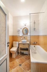 A bathroom at Prestige Palace Hotel