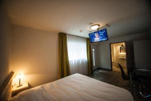 Een TV en/of entertainmentcenter bij Hotel Taurus