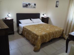 A bed or beds in a room at B&B A Casa Di Nonna