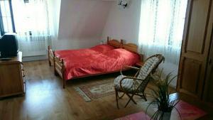 Łóżko lub łóżka w pokoju w obiekcie Dom Nad Morzem Chłopy