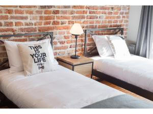 A bed or beds in a room at Well Well Aparthotel