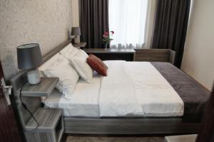 Кровать или кровати в номере Hotel Four Brothers